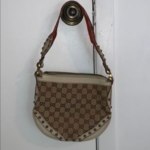 Gucci monogram shoulder bag with leather and metal